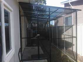 Cat enclosure on side of house